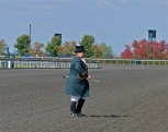 "Race track bugler preparing to play ""Call to Post"""