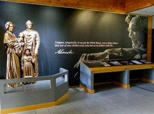 Bronze family statue inside the visitor center