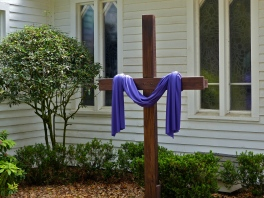 purple draped cross during Easter season