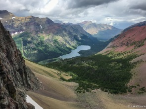 Through the Ptarmigan Tunnel, a view of Lake Elizabeth and Canada far below