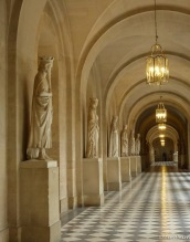 Long marble hallways filled with statues