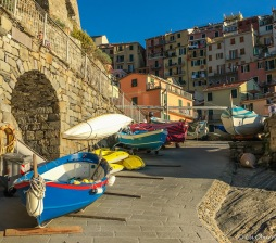 Colorful boats line the walkway