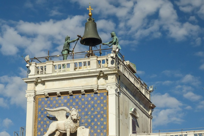 Interesting bell on a building in St. Mark's Square, along with the symbol of Venice, the winged lion. Representing the evangelist St. Mark, it appears in both merchant and military naval flags.