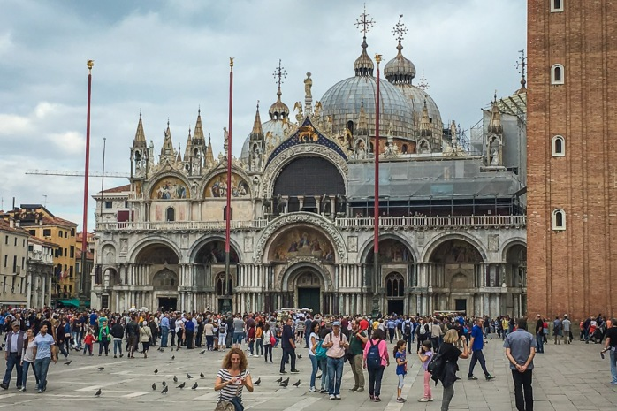 St. Mark's Square and Basilica, where the tourists and pigeons compete for space.