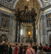 Bernini's dove window seen through the 7-story bronze canopy marking the altar where the pope says mass.