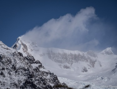 Patagonia breezes carrying snow across the peaks