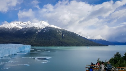 Snow-capped mountains surround Perito Moreno.