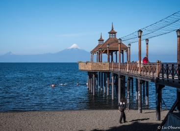Lovely wooden pier with view of Osorno Volcano across the lake.