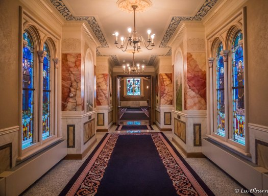 Elegant marble hallways leading to the chapel
